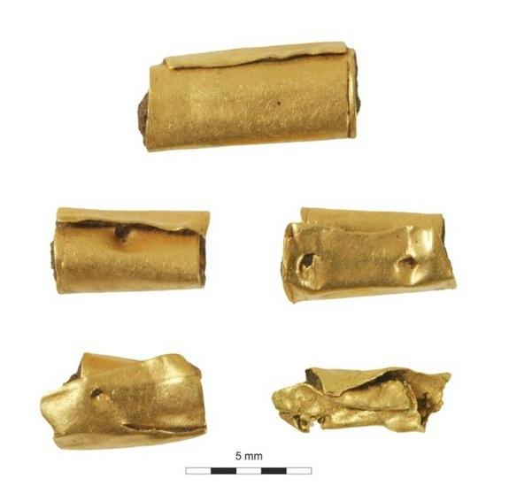 The gold beads found in the ancient woman's grave