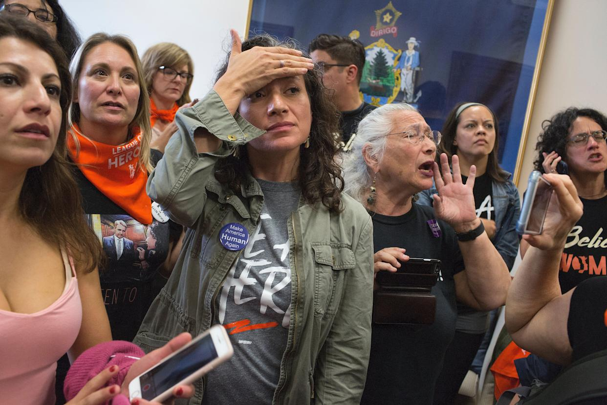 Women's rights activists opposed to Brett Kavanaugh's nomination to the Supreme Court occupy Senator Susan Collins of Maine's office and listen to her speech on the Senate floor explaining why she is supporting the nomination on October 5, 2018, in Washington, D.C. (Photo: Andrew Lichtenstein via Getty Images)