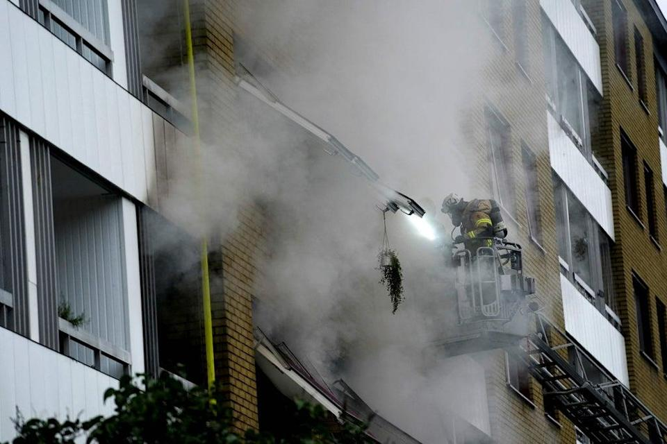Dozens of firefighters were sent to the block (TT News Agency/AFP/Getty)