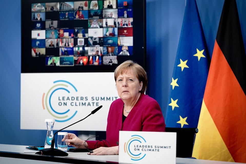<p>German Chancellor Angela Merkel takes part in a virtual Leaders Summit on Climate hosted by the US President in Berlin on April 22, 2021.</p> (Photo by KAY NIETFELD/POOL/AFP via Getty Images)