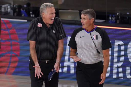 Houston Rockets head coach Mike D'Antoni, left, gestures as he talks to official Scott Foster, right, during the first half of an NBA first-round playoff basketball game against the Oklahoma City Thunder in Lake Buena Vista, Fla., Wednesday, Sept. 2, 2020. (AP Photo/Mark J. Terrill)