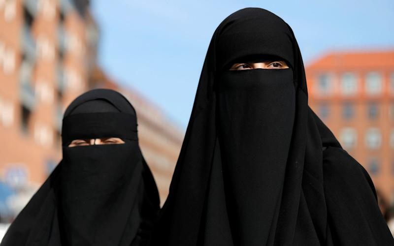 A doctor has been reported to the GMC for asking a patient to remove her veil during a constulation - REUTERS