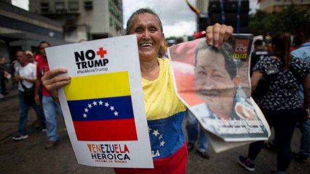 PHOTO: A supporter of President Nicolas Maduro holds a poster that in Spanish reads 'No more Trump' and an image of Late President Hugo Chavez, during an anti-imperialist rally in Caracas, Venezuela, August 31, 2019. (Ariana Cubillos/AP)