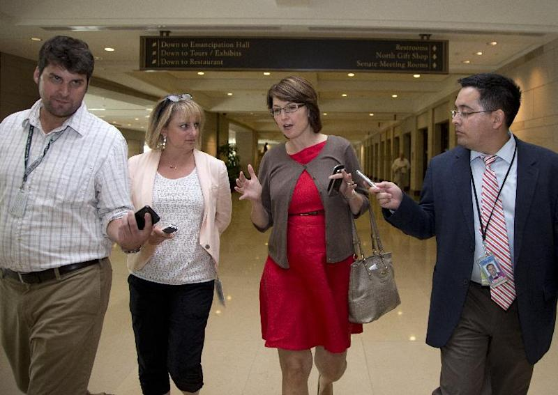 Rep. Cathy McMorris-Rodgers, R-Wash., third from left, walks with media from closed members-only briefing on Syria on Capitol Hill, Sunday, Sept. 1, 2013, in Washington. The Obama administration on Sunday confidently predicted congressional backing for limited action in Syria. (AP Photo/Carolyn Kaster)