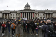 Protestors gather in Trafalgar Square, during a coronavirus anti-lockdown protest, in London, Saturday, Oct. 24, 2020. (AP Photo/Alberto Pezzali)