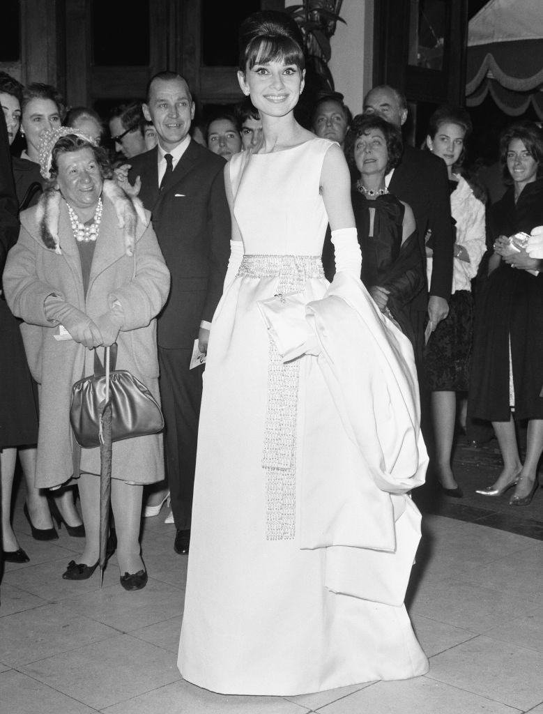 <p>Aubrey Hepburn arrives at the London premiere for <em>Breakfast at Tiffany's</em> on October 19, 1961. Hepburn's iconic black dress from the film was custom made for the actress and sold for $900,000 at a 2006 auction.</p>