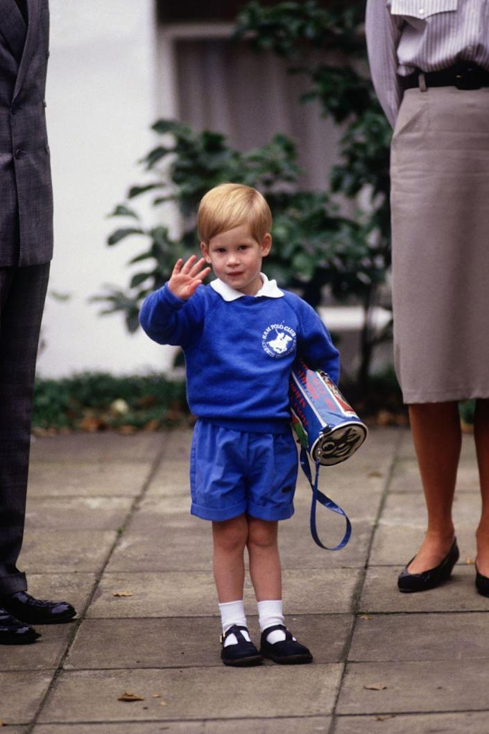 <p>Harry, 3, waves to photographers as he arrives in a matching blue sweater and shorts outfit for his first day of nursery school at Mrs. Mynor's in Notting Hill, London. Big brother William also attended Mrs. Mynors, which was based on the Montessori teaching principles.</p>