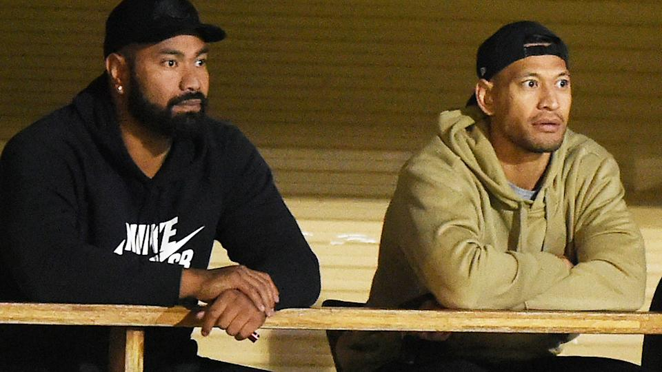 Tony Williams and Israel Folau, pictured here watching the Southport Tigers' loss to Burleigh Bears.