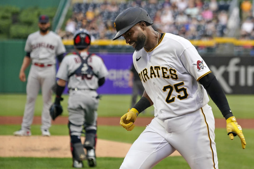 Pittsburgh Pirates' Gregory Polanco (25) returns to the dugout after hitting a two-run home run off Cleveland Indians pitcher Jean Carlos Mejia, left, during the first inning of a baseball game in Pittsburgh, Friday, June 18, 2021. (AP Photo/Gene J. Puskar)