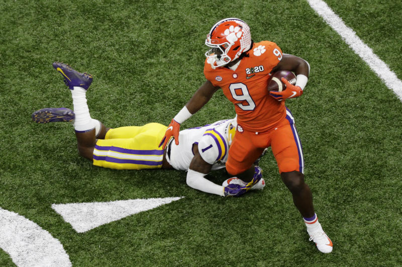 Clemson running back Travis Etienne is tackled by LSU cornerback Kristian Fulton during the first half of a NCAA College Football Playoff national championship game Monday, Jan. 13, 2020, in New Orleans. (AP Photo/Eric Gay)