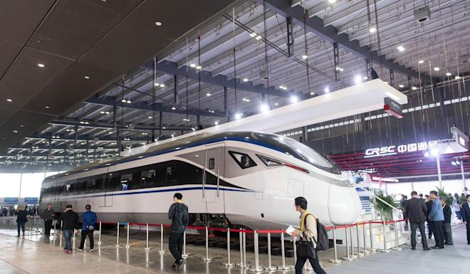 Visitors last month to the China International Rail Transit and Equipment Manufacturing Industry Expo in Changsha, took in a high-speed intercity train made by CRRC. The company's US operations are threatened by Washington's plans to block all federal funding to CRRC projects, citing national security concerns. Photo: Xinhua