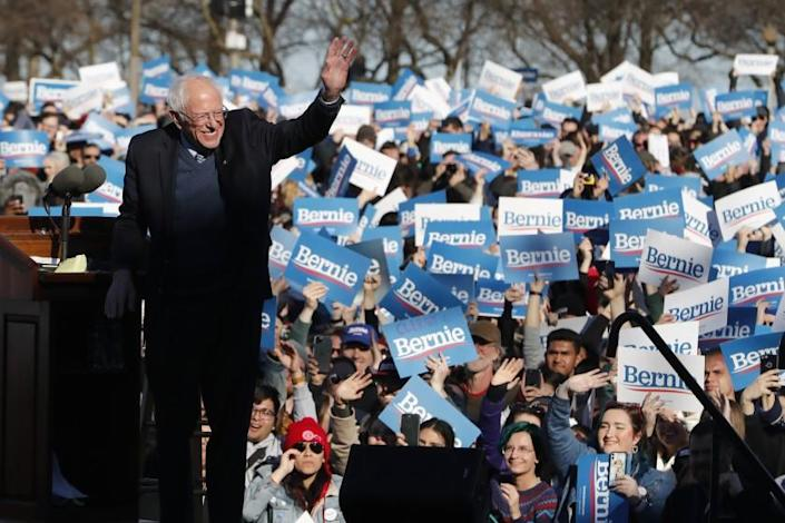 "Sen. Bernie Sanders waves to supporters at a campaign rally in Chicago's Grant Park on March 7. <span class=""copyright"">(Charles Rex Arbogast / Associated Press)</span>"