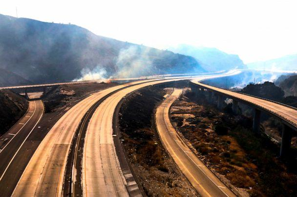 PHOTO: Freeway 5 and 14 are closed to traffic through Newhall Pass due to Saddle Ridge fire Oct. 11, 2019, in Newhall, Calif. (Irfan Khan/Los Angeles Times via Getty Images)