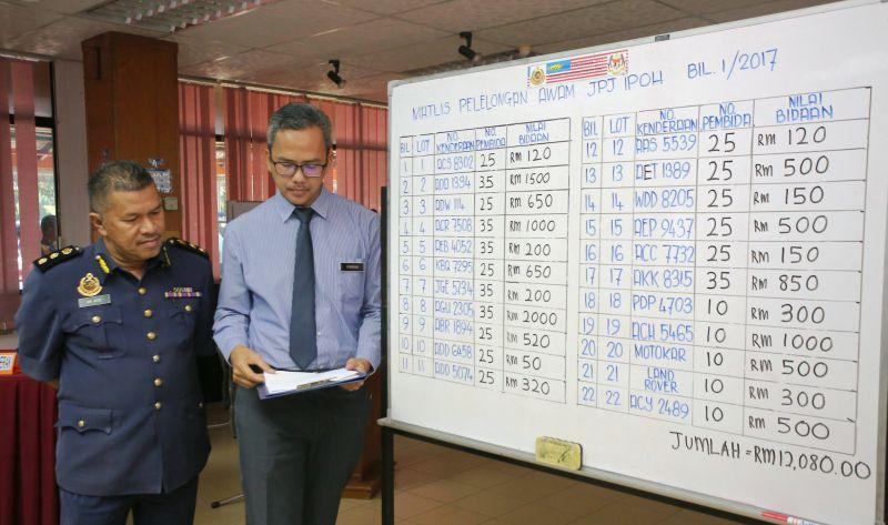 At Perak RTD auction, intense bidding for confiscated vehicles