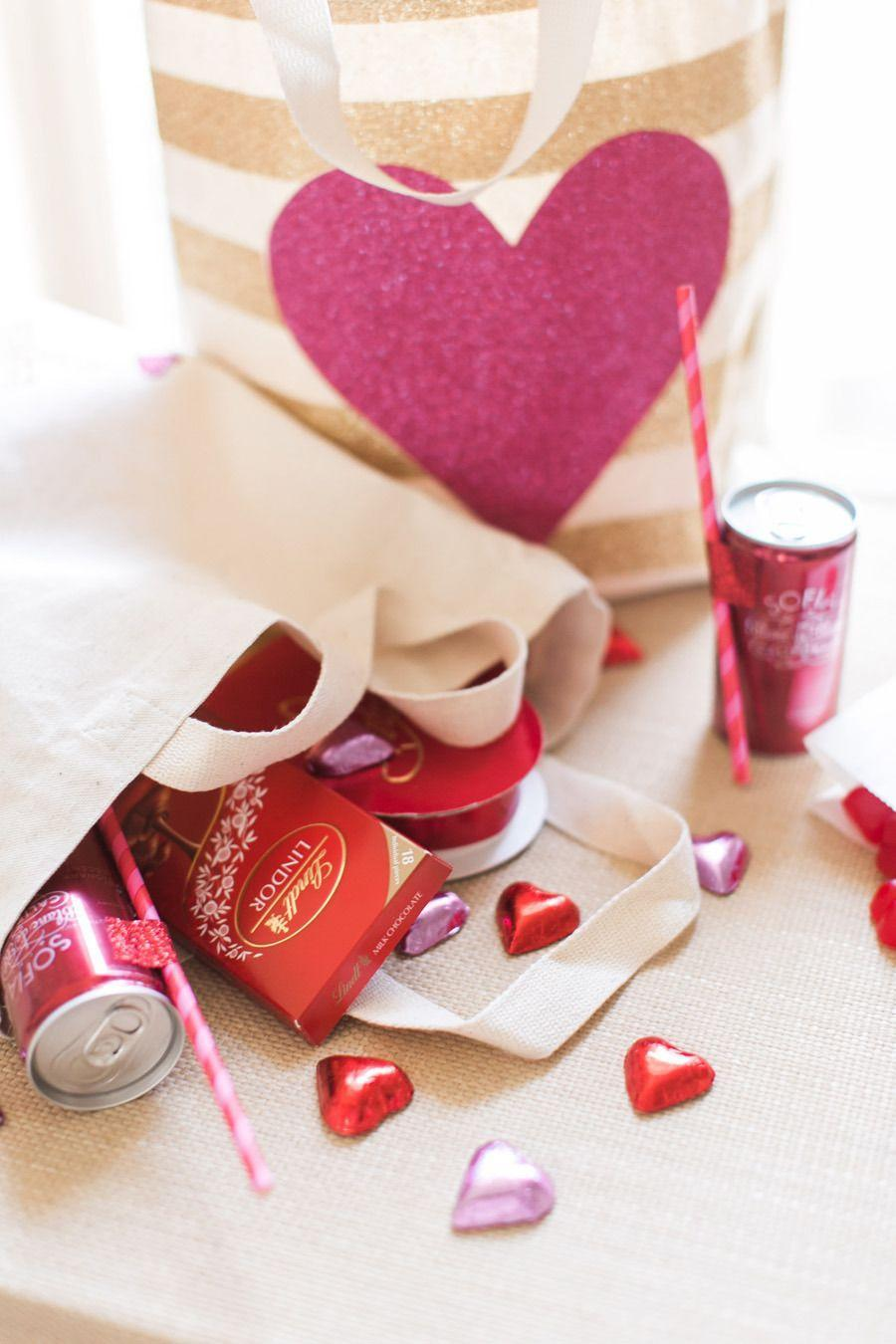 "<p>Celebrating Valentine's Day with a small group? Make adorably on-theme goodie bags, decorated with sparkling hearts and packed with pink-and-red treats. </p><p><em>Via <a href=""https://www.stylemepretty.com/vault/image/2513091"" rel=""nofollow noopener"" target=""_blank"" data-ylk=""slk:Style Me Pretty"" class=""link rapid-noclick-resp"">Style Me Pretty</a> and <a href=""http://rutheileenphotography.com/"" rel=""nofollow noopener"" target=""_blank"" data-ylk=""slk:Ruth Eileen Photography"" class=""link rapid-noclick-resp"">Ruth Eileen Photography</a></em></p><p><a class=""link rapid-noclick-resp"" href=""https://www.target.com/p/2ct-valentine-39-s-cub-bag-stripes-solid-red-spritz-8482/-/A-80172884#lnk=sametab"" rel=""nofollow noopener"" target=""_blank"" data-ylk=""slk:GET THE LOOK"">GET THE LOOK</a><em><br>2ct Valentine's Bags, Target, $3</em></p>"