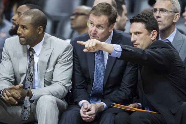 (From left to right) David Vanterpool, Terry Stotts and Nate Tibbets keep a close eye on the Blazers during an October game. (AP)