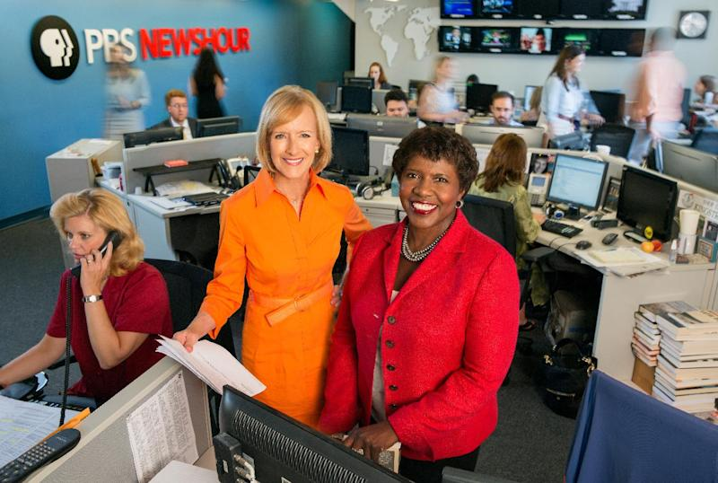 """This image provided by PBS shows co-anchors Judy Woodruff, left, and Gwen Ifill in the newsroom of """"PBS Newshour,"""" a national news program. Ifill and Woodruff are the first women to co-anchor a national daily news program on television. (AP Photo/PBS, Robert Severi)"""