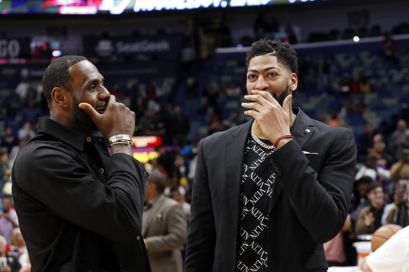 Los Angeles Lakers forward LeBron James (23) and New Orleans Pelicans forward Anthony Davis (23) after an NBA basketball game in New Orleans, Sunday, March 31, 2019. The Lakers won 130-102. (AP Photo/Tyler Kaufman)