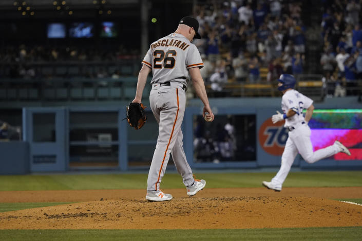 San Francisco Giants starting pitcher Anthony DeSclafani stands on the mound after giving up a two-run home run to Los Angeles Dodgers' Will Smith, right, during the fourth inning of a baseball game Thursday, July 22, 2021, in Los Angeles. (AP Photo/Marcio Jose Sanchez)