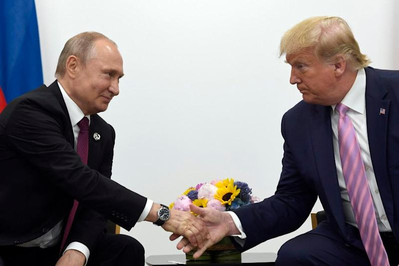 President Donald Trump, right, shakes hands with Russian president Vladimir Putin, left, during a bilateral meeting on the sidelines of the G-20 summit in Osaka, Japan 28 June 2019: Susan Walsh/AP