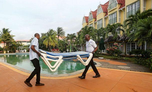 PHOTO: Hotel employees remove beach cots from the pool area in preparation for the arrival of Tropical Storm Dorian in Gros Islet, St. Lucia, Aug. 26, 2019. (Andrea de Silva/Reuters)
