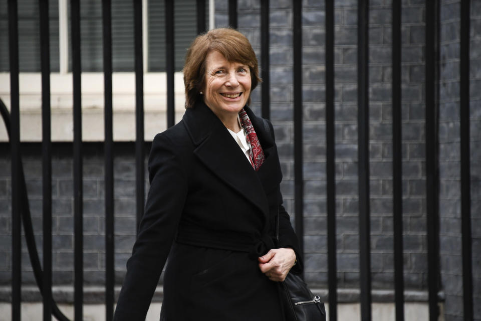 June Raine, head of the Medicines and Healthcare Products Regulatory Agency (MHRA) leaves 10 Downing Street after attending a press conference on AstraZeneca Plc and the University of Oxford vaccine, in London, Wednesday, Dec. 30, 2020.(AP Photo/Alberto Pezzali)