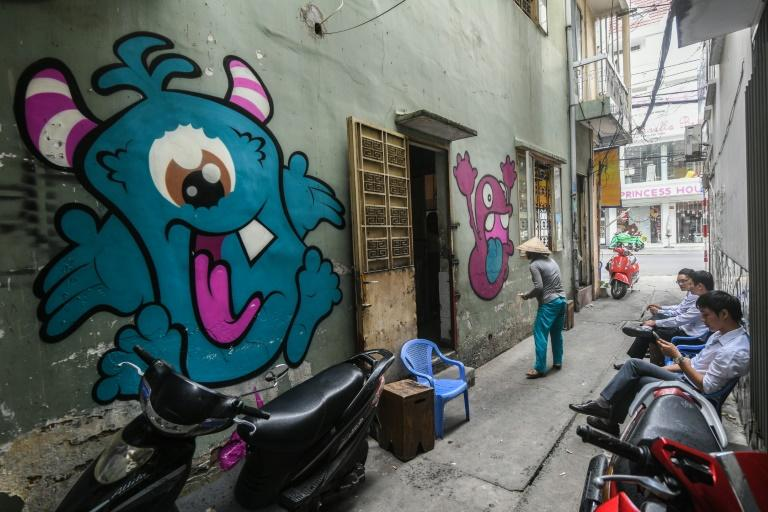 Illicit spray-painting is a way of defying restrictions in uthoritarian Vietnam where artists must have their work approved before exhibitions, shows are routinely shut down, and works deemed controversial are replaced by a black 'X' on gallery walls