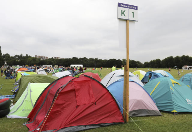 """In this Tuesday, July 9, 2019, the tents of tennis fans are queued up to get tickets to enter the Wimbledon Tennis Championships in London. For many the Wimbledon experience starts in a tent as they gather in a small park across from the tournament grounds to camp out, some for days, in the hope of getting a ticket to Centre Court. """"The Queue"""" is a decades-old tradition that has grown to become its own phenomenon.(AP Photo/Natasha Livingstone)"""