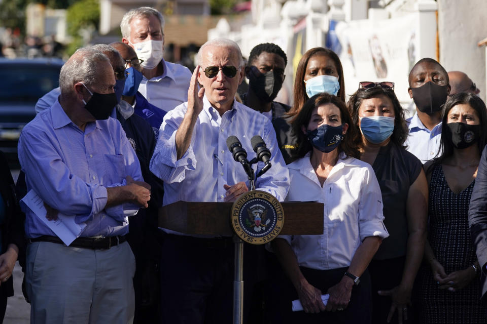 President Joe Biden speaks as he tours a neighborhood impacted by flooding from the remnants of Hurricane Ida, Tuesday, Sept. 7, 2021, in the Queens borough of New York. (AP Photo/Evan Vucci)