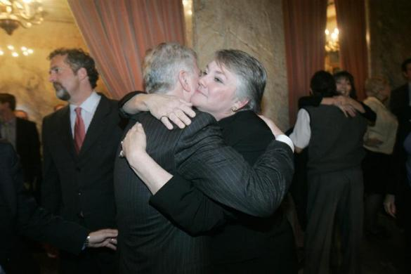 Washington State Senator Ed Murray (L) is congratulated by Republican Rep. Maureen Walsh after the State House of Representatives passed a bill endorsing gay marriage in the state, in Olympia February 8, 2012. Walsh was a co-sponsor of the bill.