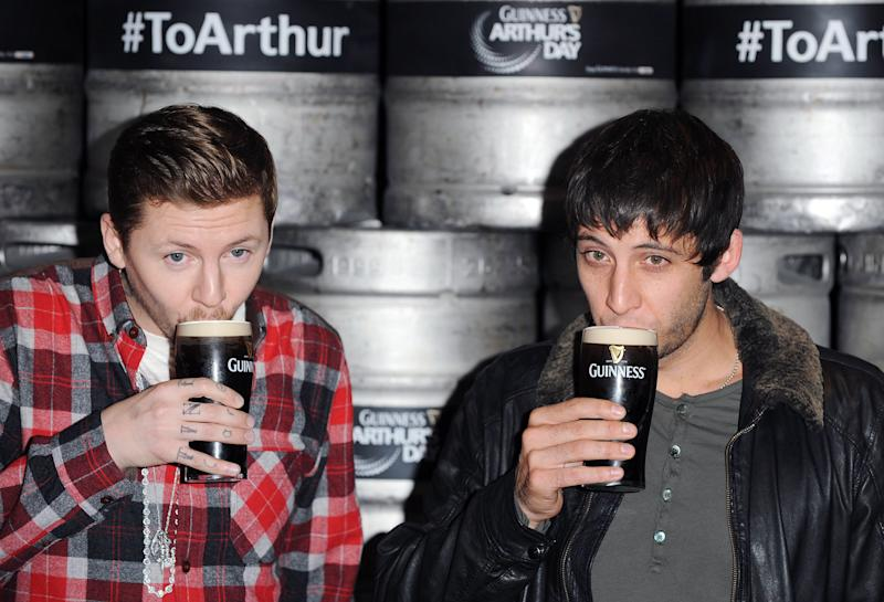 DUBLIN, IRELAND - SEPTEMBER 27: Professor Green and Example attend a photocall at The Morrison Hotel as final preparations for this evening's Arthur's Day celebrations get under way on September 27, 2012 in Dublin, Ireland. Arthur's Day taking place on September 27 celebrates the life and legacy of Arthur Guinness, the man behind the iconic pint. Arthur's Day sees fans come together to experience live music events in over 500 pub venues across Ireland. It promises to be an extraordinary night of live music featuring hundreds of home grown Irish acts, rising stars and internationally renowned artists such as Example, Tinie Tempah, Ellie Goulding, Mika, Professor Green, Fat Boy Slim, Texas, Fun Lovin' Criminals, Amy Macdonald, Primal Scream and Mumford & Sons. For more information visit www.guinness.com or the Guinness Ireland Facebook page. (Photo by Stuart Wilson/Getty Images for Guinness)