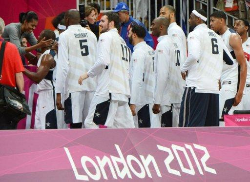 US basketball players are congratulated by US First Lady Michelle Obama after they won 98-71 the Men's Preliminary Round Group A match United States vs France at the London 2012 Olympic Games, in London