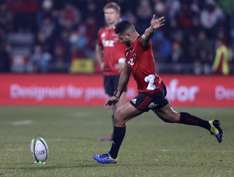 Crusaders Richie Mo'unga takes a penalty shot at goal during the Super Rugby final between the Crusaders and the Jaguares in Christchurch, New Zealand, Saturday, July 6, 2019. (AP Photo/Mark Baker)