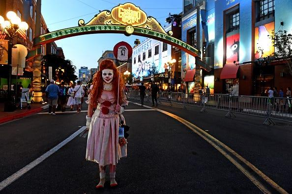 "Anna Niebla of San Diego cosplays as Pennywise from Stephen King's ""It"" in the Gaslamp Quarter during San Diego Comic-Con preview night at the San Diego Convention Center on July 18, 2018."