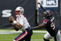 New England Patriots quarterback Cam Newton (1) is pressured by Houston Texans defensive end Charles Omenihu (94) during the second half of an NFL football game, Sunday, Nov. 22, 2020, in Houston. (AP Photo/David J. Phillip)