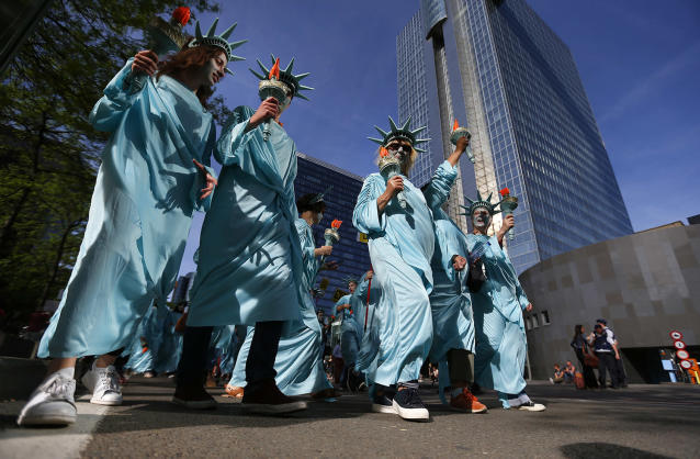 <p>Protesters dressed as the Statue of Liberty march during a demonstration in the center of Brussels on May 24, 2017. Demonstrators marched in Brussels ahead of a visit of US President Donald Trump and a NATO heads of state summit which will take place on Thursday. (Photo: Peter Dejong/AP) </p>