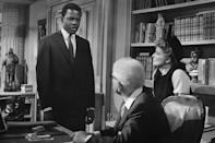 <p>On screen with Spencer Tracy and Katharine Hepburn in 1967's <em>Guess Who's Coming to Dinner, </em>one of the biggest films of his career. The film also drew attention for dealing with race: Poitier played the Black fiancé of a white woman, meeting her parents for the first time.</p>
