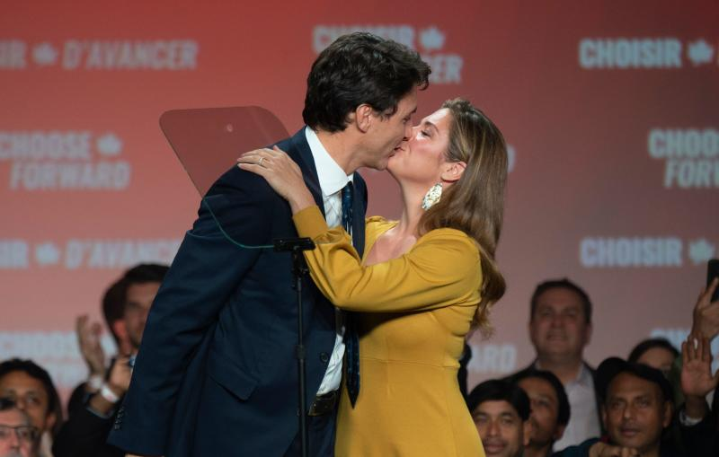 TOPSHOT - Prime minister Justin Trudeau kisses his wife Sophie Grégoire Trudeau at the Palais des Congres in Montreal during Team Justin Trudeau 2019 election night event in Montreal, Canada on October 21, 2019. - Prime Minister Justin Trudeau's Liberal Party held onto power in a nail-biter of a Canadian general election on Monday, but as a weakened minority government. Television projections declared the Liberals winners or leading in 157 of the nation's 338 electoral districts, versus 121 for his main rival Andrew Scheer and the Conservatives, after polling stations across six time zones closed. (Photo by Sebastien ST-JEAN / AFP) (Photo by SEBASTIEN ST-JEAN/AFP via Getty Images)