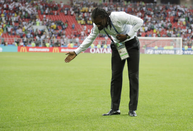 Senegal's head coach Aliou Cisse bows as his team won the group H match between Poland and Senegal at the 2018 soccer World Cup in the Spartak Stadium in Moscow, Russia, Tuesday, June 19, 2018. Senegal won 2-1. (AP Photo/Andrew Medichini)