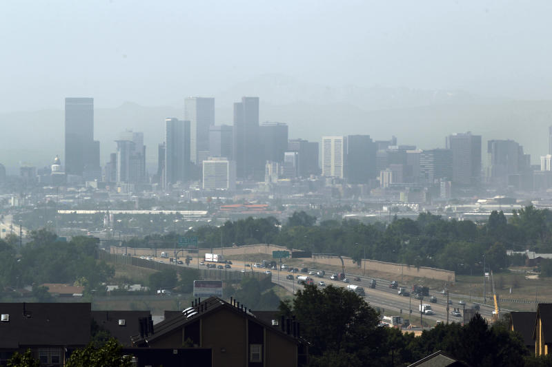 Traffic flows into the city of Denver on Interstate 25 as heavy smoke from the High Park wildfire near Fort Collins, Colo., shrouds the city on Tuesday, June 12, 2012. Authorities have issued health warnings as smoke and haze from the wildfire 60 miles to the north have blanketed the front range. (AP Photo/Ed Andrieski)