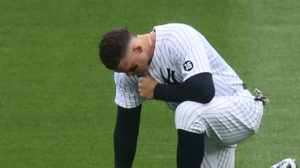 Aaron Judge kneels in outfield on Opening Day
