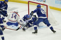 Tampa Bay Lightning goaltender Andrei Vasilevskiy (88) stops a shot by Montreal Canadiens center Nick Suzuki (14) during the first period in Game 1 of the NHL hockey Stanley Cup finals, Monday, June 28, 2021, in Tampa, Fla. (AP Photo/Gerry Broome)