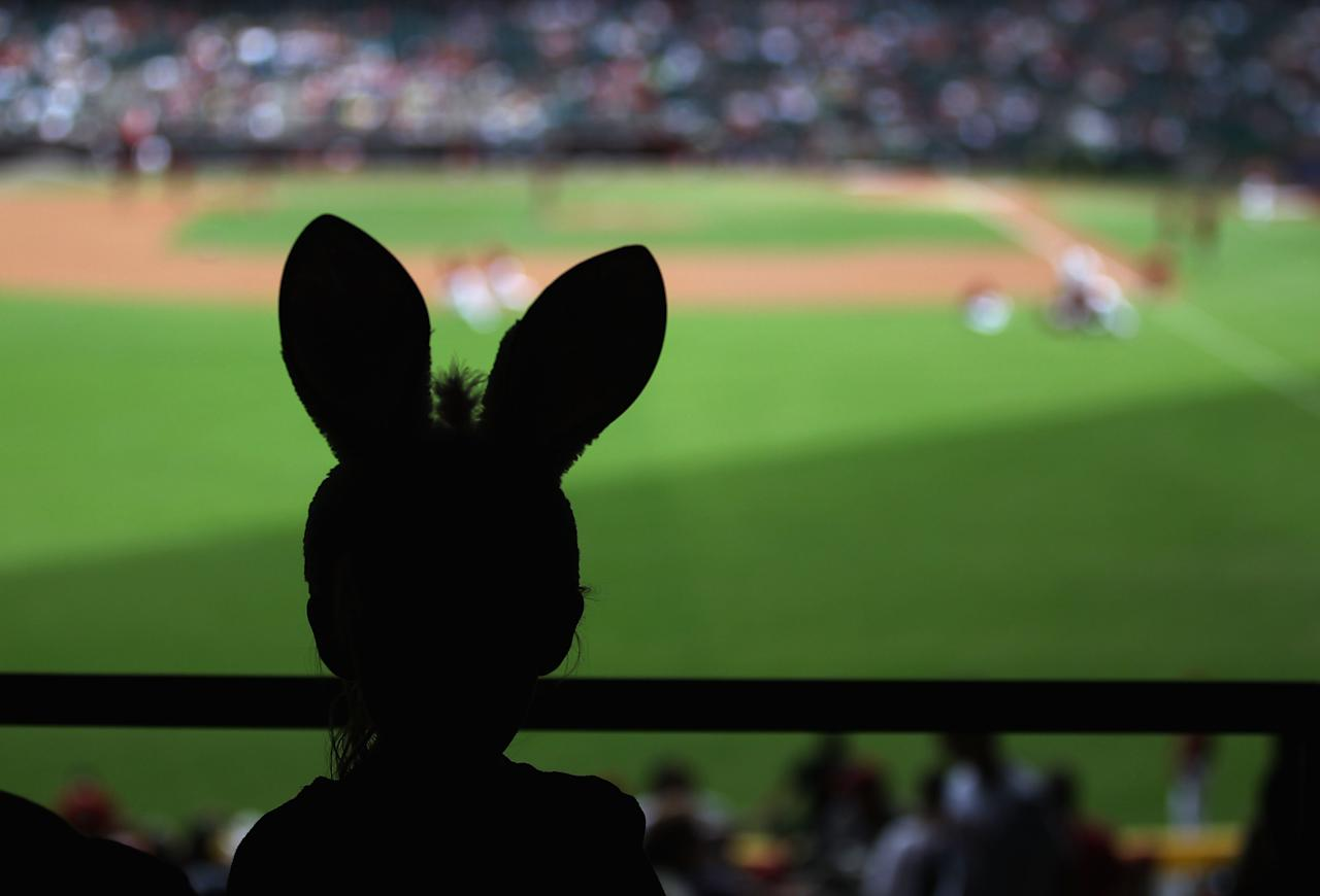 PHOENIX, AZ - APRIL 08:  A young fan, wearing bunny ears in honor of Easter, attends the MLB game between the San Francisco Giants and the Arizona Diamondbacks at Chase Field on April 8, 2012 in Phoenix, Arizona.  (Photo by Christian Petersen/Getty Images)