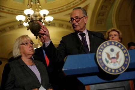 Senate Minority Leader Chuck Schumer, accompanied by Senator Patty Murray (D-WA) and Senator Debbie Stabenow (D-MI), speaks with reporters following the successful vote to open debate on a health care bill on Capitol Hill in Washington, U.S., July 25, 2017. REUTERS/Aaron P. Bernstein