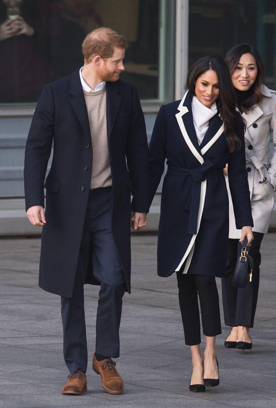 "<p><a href=""https://www.townandcountrymag.com/style/fashion-trends/a19175189/meghan-markle-jcrew-coat/"" rel=""nofollow noopener"" target=""_blank"" data-ylk=""slk:Meghan wore a chic J.Crew coat for the occasion."" class=""link rapid-noclick-resp"">Meghan wore a chic J.Crew coat for the occasion.</a></p>"