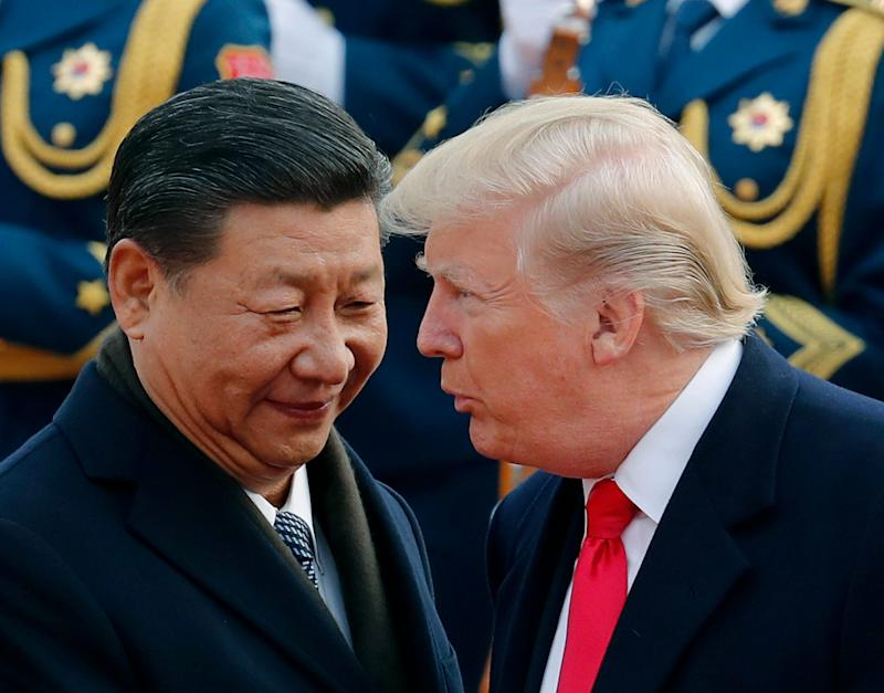 President Donald Trump, right, talks with Chinese President Xi Jinping during a welcome ceremony at the Great Hall of the People in Beijing on Nov. 9, 2017.