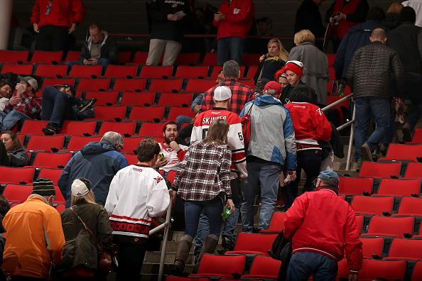 """RALEIGH, NC – DECEMBER 19: Fans leave the building following an announcement that an NHL game between the <a class=""""link rapid-noclick-resp"""" href=""""/nhl/teams/car/"""" data-ylk=""""slk:Carolina Hurricanes"""">Carolina Hurricanes</a> and the <a class=""""link rapid-noclick-resp"""" href=""""/nhl/teams/det/"""" data-ylk=""""slk:Detroit Red Wings"""">Detroit Red Wings</a> is postponed due to a mechanical failure in the system that makes the ice surface on December 19, 2016 at PNC Arena in Raleigh, North Carolina. (Photo by Gregg Forwerck/NHLI via Getty Images)"""