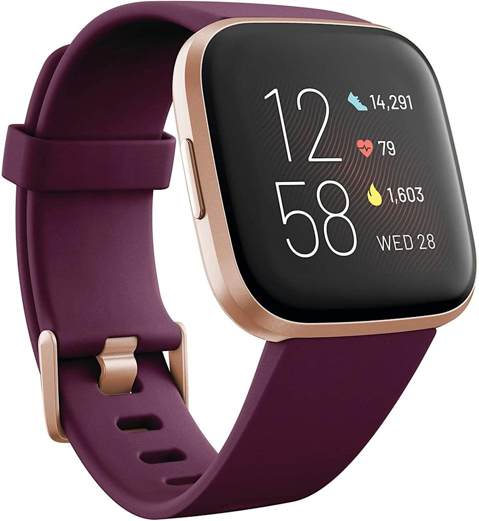 "<h2>Fitbit Versa 2 Health and Fitness Smartwatch</h2><br>Fitness enthusiasts, rejoice! Track your daily steps and monitor your heart rate during living room pilates with the new Versa 2. <br><br><strong>Fitbit</strong> Fitbit Versa 2 Health and Fitness Smartwatch, $, available at <a href=""https://www.amazon.com/Fitbit-Smartwatch-Tracking-Bordeaux-Included/dp/B07TWFWJDZ"" rel=""nofollow noopener"" target=""_blank"" data-ylk=""slk:Amazon"" class=""link rapid-noclick-resp"">Amazon</a>"