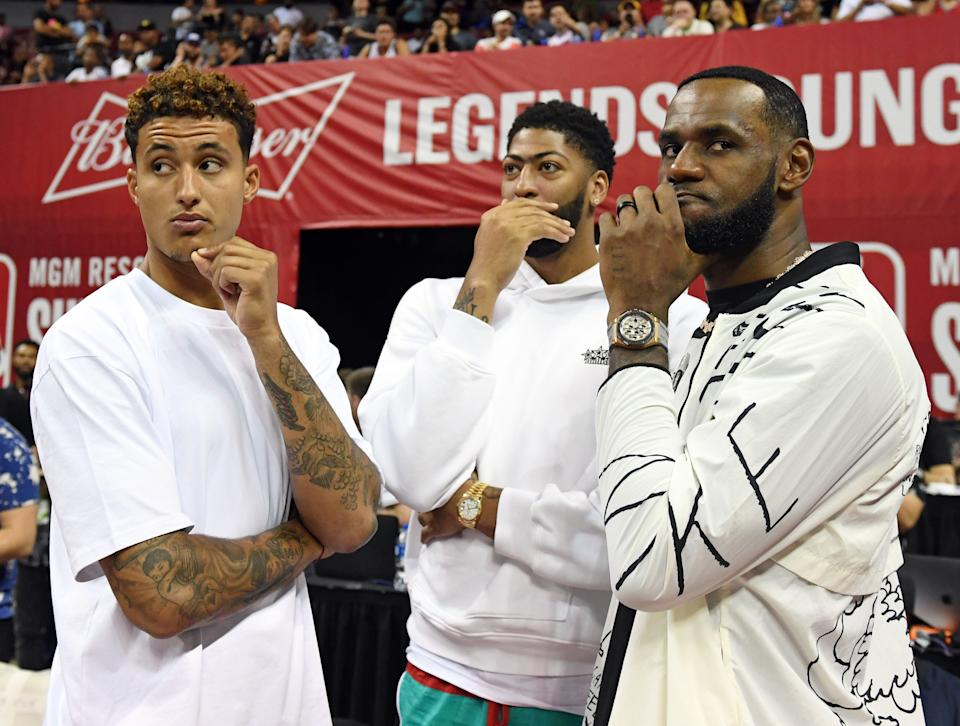LAS VEGAS, NEVAKyle Kuzma, Anthony Davis and LeBron James of the Los Angeles Lakers talk before a game between the Lakers and the LA Clippers during the 2019 NBA Summer League(Photo by Ethan Miller/Getty Images)DA - JULY 06:  (L-R) Kyle Kuzma, Anthony Davis and LeBron James of the Los Angeles Lakers talk before a game between the Lakers and the LA Clippers during the 2019 NBA Summer League at the Thomas & Mack Center on July 6, 2019 in Las Vegas, Nevada. NOTE TO USER: User expressly acknowledges and agrees that, by downloading and or using this photograph, User is consenting to the terms and conditions of the Getty Images License Agreement.  (Photo by Ethan Miller/Getty Images)