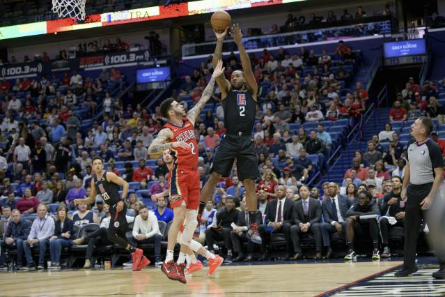 Los Angeles Clippers forward Kawhi Leonard (2) shoots against New Orleans Pelicans guard Lonzo Ball (2) in the first half an NBA basketball game in New Orleans, Saturday, Jan. 18, 2020. (AP Photo/Matthew Hinton)
